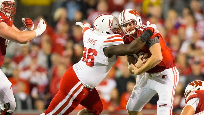 Wisconsin quarterback Bart Houston (right) was coach Paul Chryst's pick to lead the Badgers in overtime Saturday night against the Nebraska Cornhuskers.