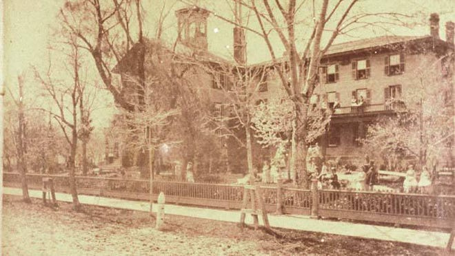This photo shows the Boyd Seminary for Girls as it appeared circa 1878. Founded by Rev. Erasmus J. Boyd in 1849, the Boyd Young Ladies' Seminary served as a finishing school and community resource in Monroe for the arts and music.