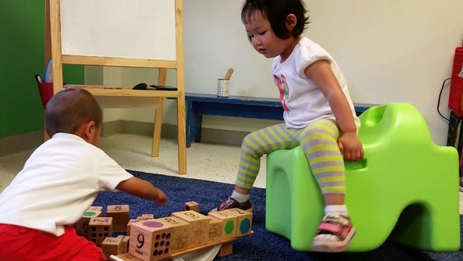 The Fidget chair, used by the child on the right, was invented by Sandra Turner, of Fairport, to help burn a child's energy and help them focus.