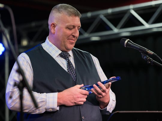 """Salisbury Police Officer, Aaron """"Bull"""" Hudson, receives the  Coolest Cop Award during the We Heart SBY Awards at Headquarters Live on South Division Street on Thursday, Feb. 18, 2016."""