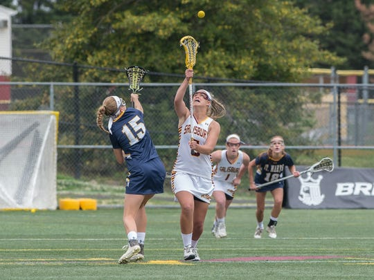 Salisbury's Kacy Koolage (5) gains possession of the ball during a game against St. Mary's College of Maryland on Saturday, April 30, 2016.