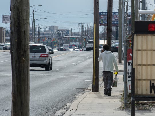 A man walks along Route 13 in Salisbury near Union Avenue and Naylor Street.