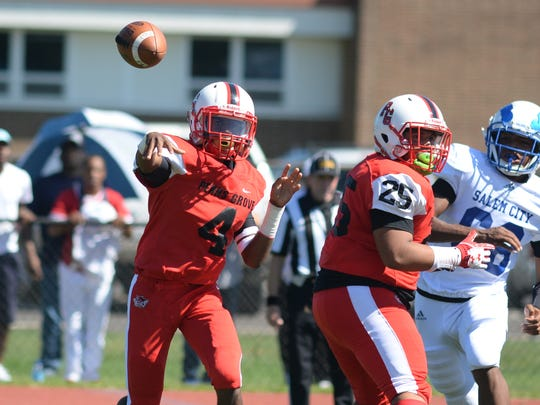 Penns Grove's Kavon Lewis (4) throws a pass during Saturday's game against Salem. 09.23.17.