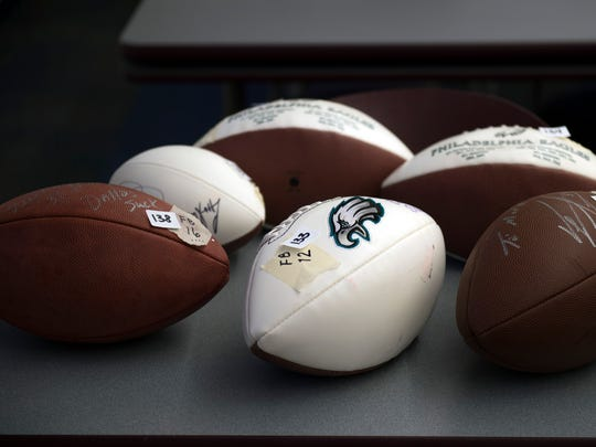 Signed Philadelphia Eagles footballs up for auction from the Burlington County Prosecutor's Office in Westampton.