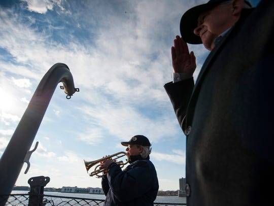 "Ship bugler Nan LaCorte plays ""The Star-Spangled Banner"" as a ceremony is held commemorating the 75th anniversary of the USS New Jersey's launch Thursday, Dec. 7, 2017 in Camden."