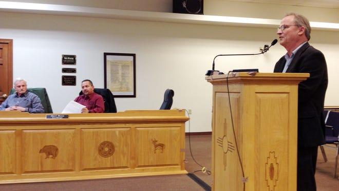 City Attorney Robert Scavron, left, and Town Manager Alex Brown listen as Silver City Museum Director Tracy Spikes, at right, discusses plans for a Territorial Charter Day on Feb. 13 during Tuesday's Silver City Town Council meeting.