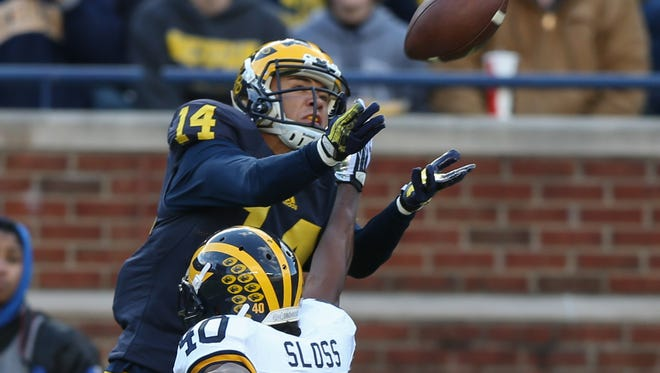 The University of Michigan Wolverines Drake Harris makes a catch against Kenneth Sloss during first half action of the Spring Game on Friday, April 1, 2016 at Michigan Stadium in Ann Arbor, Michigan.