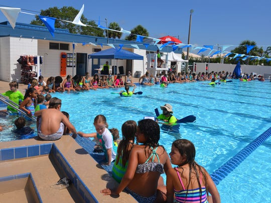 Children at the Cocoa Beach Aquatic Center participated in the world's largest swim lesson Thursday morning. Thousands of kids and families at pools, aquatic centers and water parks around the world participated in the mass swim lesson to teach water safety and prevent drowning.