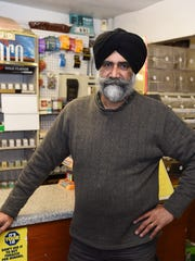 Amrik Singh stands inside his store in Staatsburgh on Saturday.  State Police arrested a suspect Saturday for the attempted robbery that occurred in Singh's store on December 15th.
