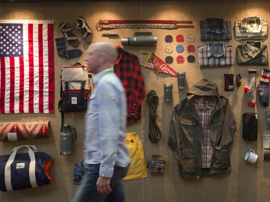 An event attendee walks past the Woolrich outdoor clothing display at the Outdoor Retailer Show on Wednesday, Aug. 5, 2015, in Salt Lake City. There has been discussion of moving the twice a year event from it's long time home in Salt Lake City, but it was announced Monday that the show will stay in Utah.