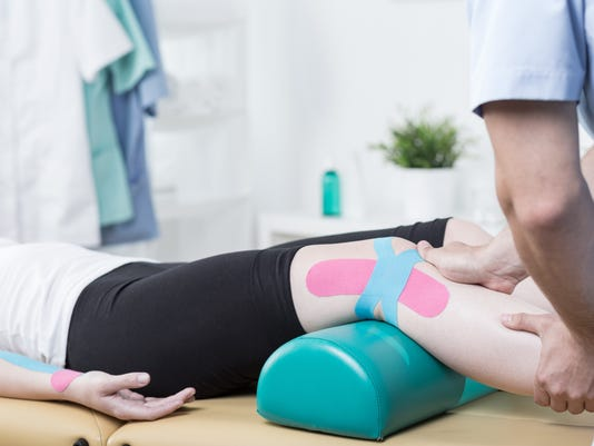 Patient with elastic therapeutic tape