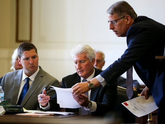Assistant Prosecutor Seth Tieger shows defense Attorney Stew Mathews evidence on the first day of Tensing's retrial in Hamilton County Common Pleas Judge Leslie Ghiz's courtroom Thursday, June 8, 2017.   Tensing, the former University of Cincinnati police officer, is charged with murder in the death of Sam DuBose, during a routine traffic stop on July 19, 2015. Tensing's lawyer, Stew Mathews, has said Tensing fired a single shot.