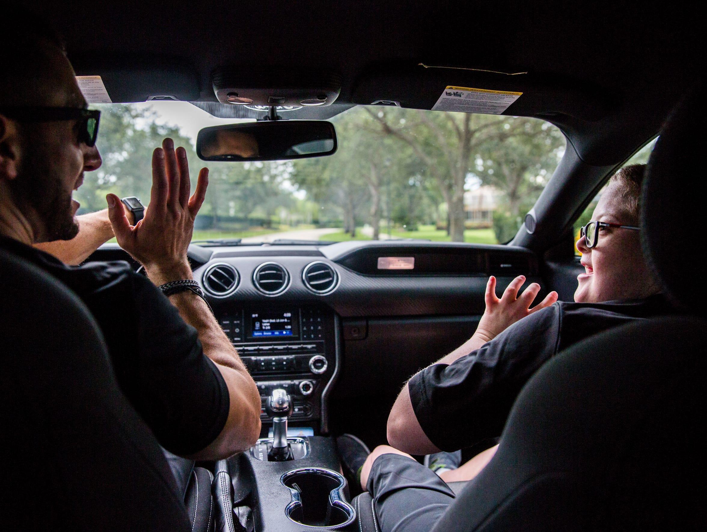 Personal trainer Sammy Callari dances in the car with
