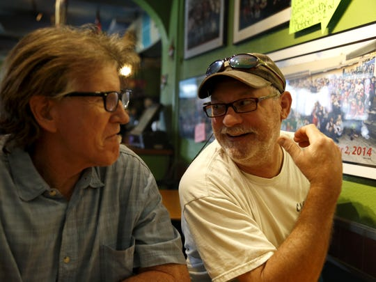 Mike Ferarra, left, and Bobby Staerker have been running Cabos Island Bar and Grill together since 1994. The two sit in the dining room of their Apalachee Parkway restaurant Oct 17.