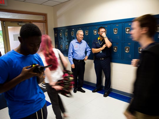Mayor Bill Barnett, left, and principal Darren Burkett stand in the hall as students head to lunch on Monday, Nov. 20, 2017, at Naples High School.