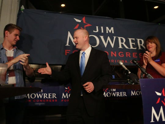 Jim Mowrer, winner of the 3rd district congressional democratic primary shakes hands with Max Tensen, 17 of Des Moines, during a party to celelbrate the win on Tuesday, June 7, 2016, at Saints Pub and Patio in Des Moines.