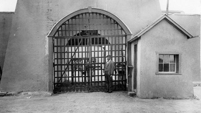 """The Yuma Territorial Prison in its 19th-century heyday. Locals called it """"the hotel,"""" but it was no resort. The entrance to the Yuma Territorial Prison, circa 1800s."""