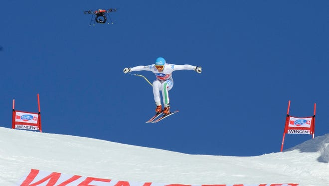 A drone flies behind Christof Innerhofer while he competes in the World Cup men's downhill in Wengen, Austria.