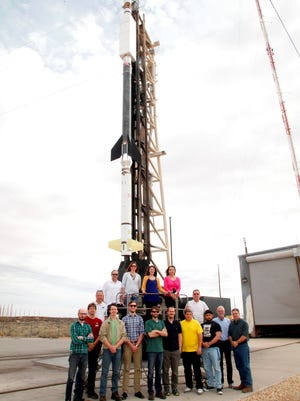 Part of the launch team poses with the Terrier Black Brant rocket on the launcher at Launch Complex 36.