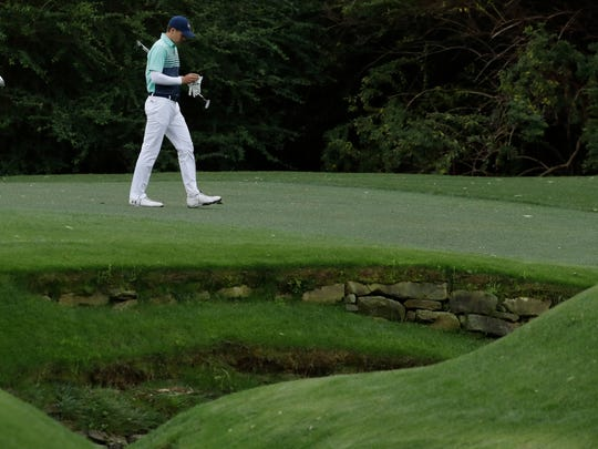 Jordan Spieth makes his way to the 13th green during the first round for the Masters golf tournament Thursday, April 6, 2017, in Augusta, Ga. (AP Photo/Charlie Riedel)