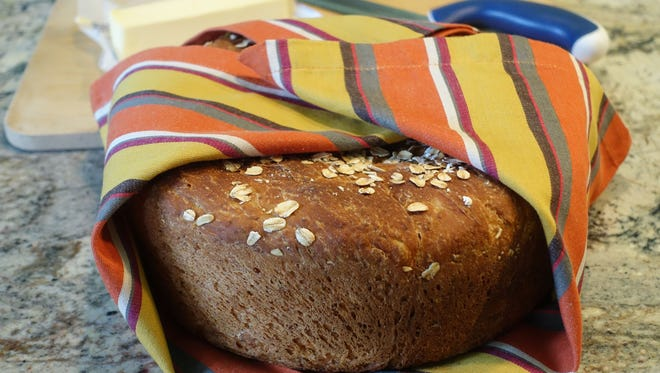 No-Knead Oatmeal Bread produces a large, high loaf.