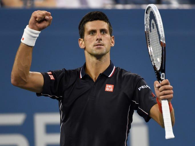 Novak Djokovic celebrates his quarterfinal victory over Andy Murray.