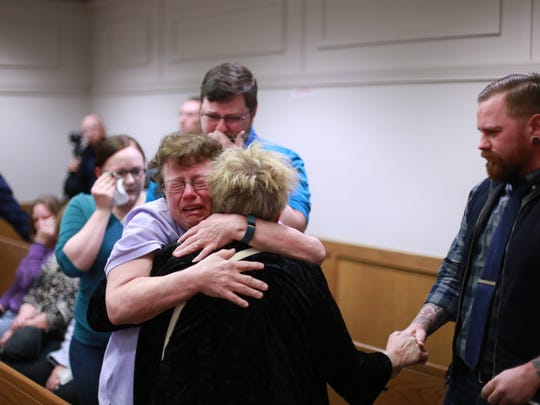Members of Timothy and Christie Fradereck's families comfort each other before he is arraigned in the 38th District Court in Eastpointe on Wednesday, April 15, 2015, in the deaths of his wife and children.