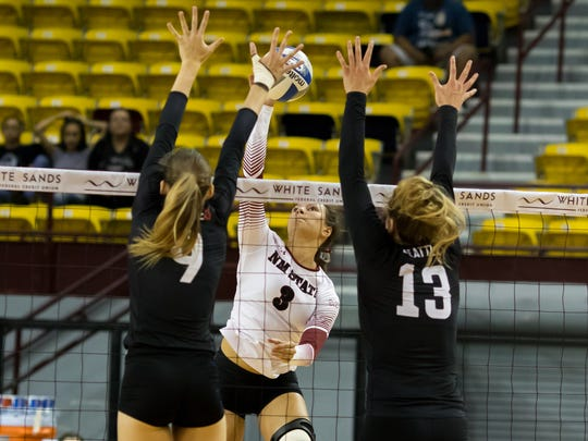 Jordan Abalos finds a gap between Seattle blockers in Thursday night's WAC volleyball match on Thursday at the Pan American Center.