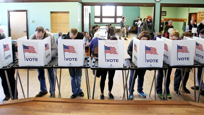 Voters cast their ballots at the Wil-Mar Neighborhood Center on the Near East Side of Madison, Wis., Nov. 8, 2016.