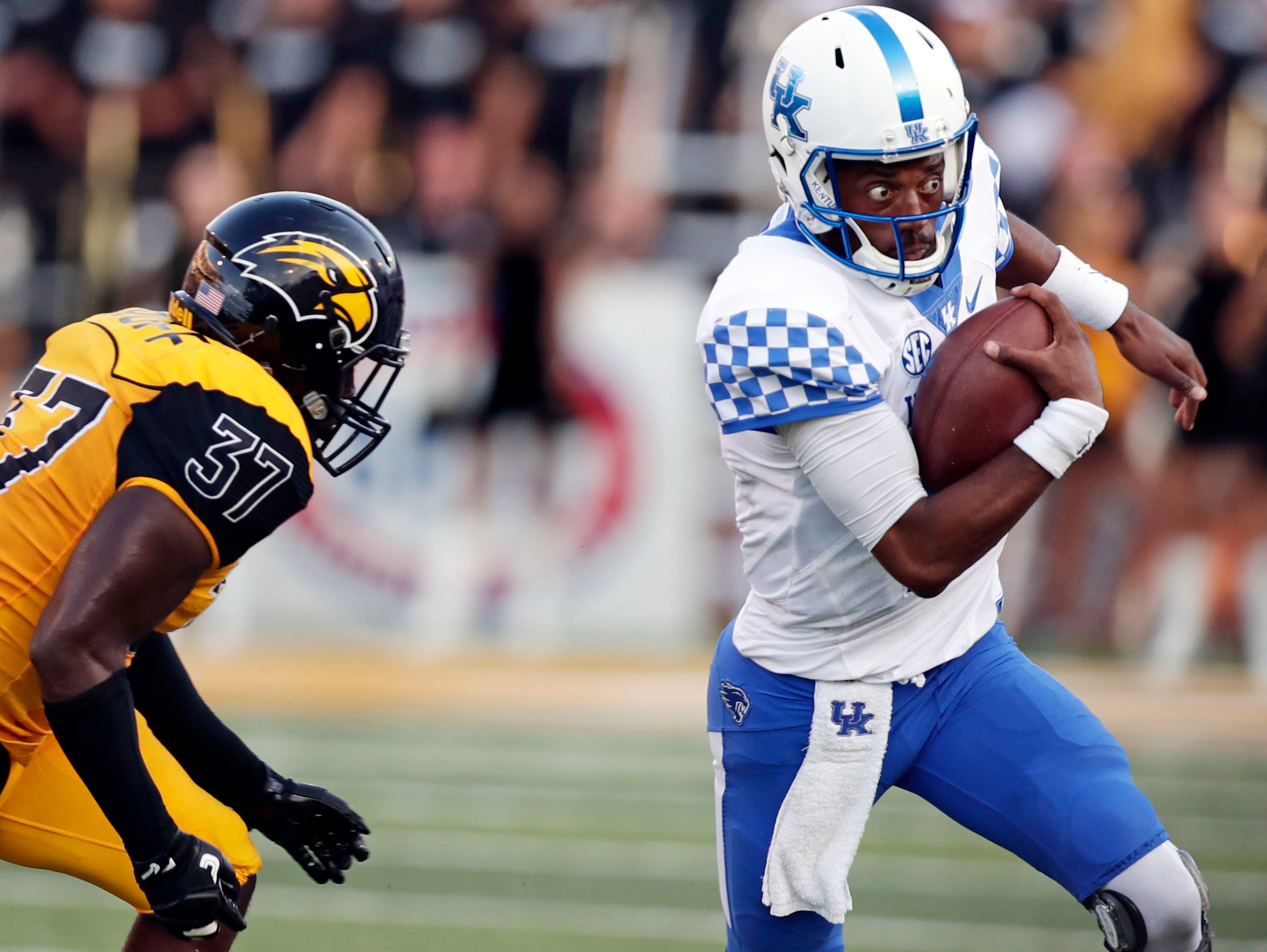 Kentucky quarterback Stephen Johnson (15) runs away from Southern Mississippi linebacker Sherrod Ruff (37) as he avoids being sacked during the second half of an NCAA college football game against Southern Mississippi in Hattiesburg.