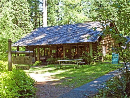The South Falls Nature Store is located within the log cabin on the grounds of Silver Falls State Park.