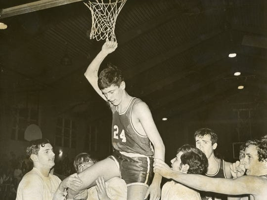 Kevin Billerman is hoisted by his St. Joseph's-Toms