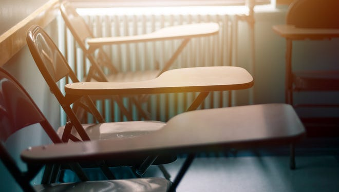 Classroom chars with desk at dusk