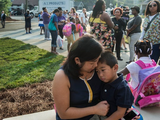 Mom Cyndya Shabao hugs her son Erick, 5, who started his first day of school at Metro newest school at Waverly-Belmont  Elementary on Wednesday Aug. 5, 2015, in Nashville in Tenn.