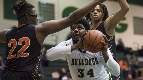 Berea's Jaylan Gordon (34) attempts to shoot while defended by Southside's Taymon Leamon (22) and R.J. Campbell during the visiting Tigers' 75-44 victory Tuesday night.