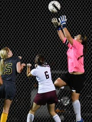 Lady Colonel goalie Ashlee Wilson catches the ball