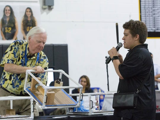 Andres Romero, a student at the New Mexico for the Blind and Visually Impaired  explains his schools payload experiment to the students from around the district gathered at Alamogordo High School, during a Space Station Inflight Downlink event Wednesday Feb 21, 2018. The experiment set out to find out how feathers and weights float in zero gravity.