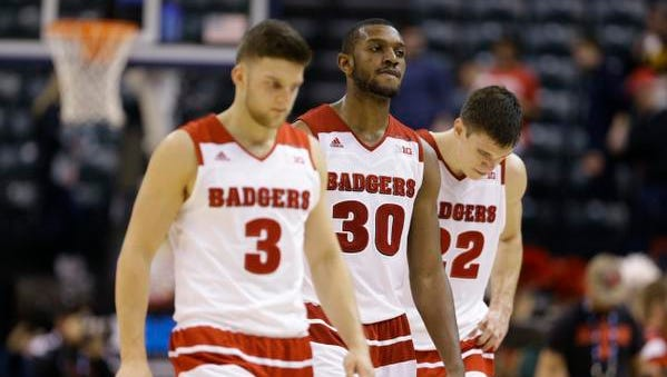 Wisconsin's Zak Showalter (3), Vitto Brown (30) and Ethan Happ (22) walk off the court after an NCAA college basketball game at the Big Ten Conference tournament, Thursday, March 10, 2016, in Indianapolis. Nebraska won 70-58.