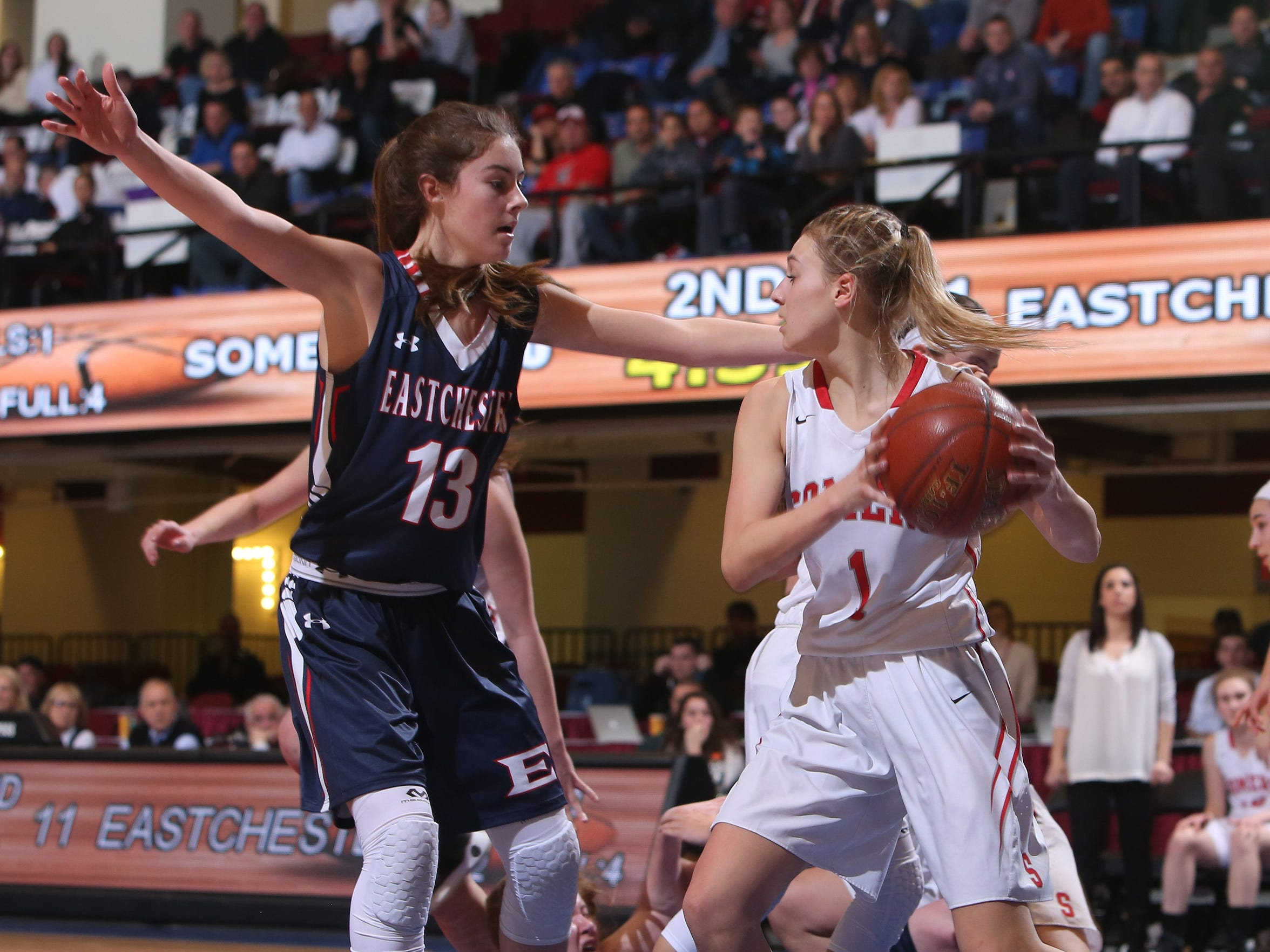 From left, Eastchester's Cassidy Mitchell  (13) blocks