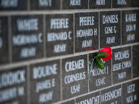 A single rose taped to a tile honors a soldier during the Memorial Day and 10th anniversary ceremony at Montana Veterans Memorial Monday.