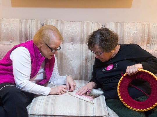 Vicky Robinson, left, and Sandy Rebert, both of Hanover, examine a design during a Compassionate Crafters get-together on Nov. 28, 2016  at Emmanuel United Church of Christ in Hanover.