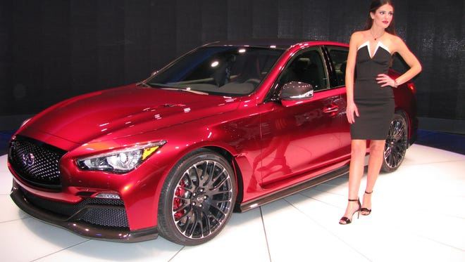 A model shows off the Infiniti Q50 Eau Rouge at the North American International Auto Show in Detroit