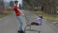 Caleb Miller, 17, spins his sister Evelyn Miller, 5,