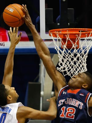 St. John's forward Chris Obekpa blocks a shot by DePaul guard R.J. Curington on Jan. 18.