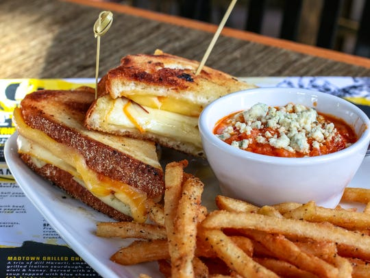 HopCat's Madtown Grilled Cheese is served with a cup