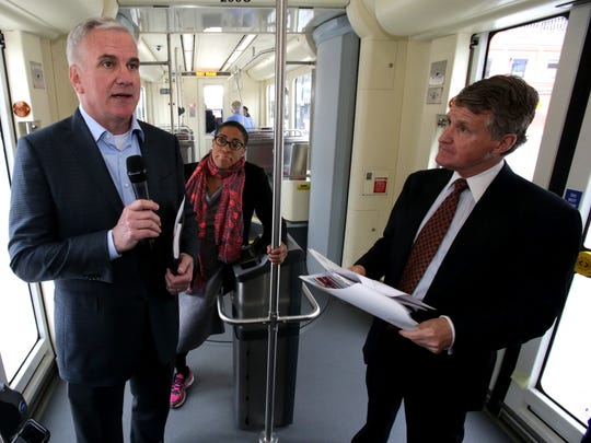 From left, Matt Cullin, CEO of M1-Rail, talks as Sommer Woods, VP of External Relations and Rip Rapson, the President of the Kresge Foundation, listen during a test ride on the QLine on Tuesday, May 29, 2017.