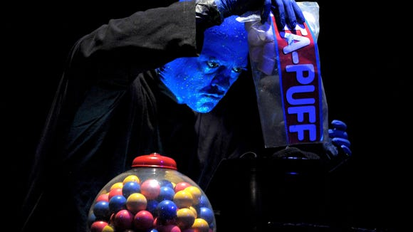 A member of the Blue Man Group chooses a marshmallow as part of a performance. The group is performing at The Luxor in Las Vegas.