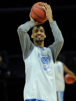 North Carolina forward J.P. Tokoto will face two former AAU teammates tonight when the Tar Heels play Wisconsin in the NCAA West Region semifinals.