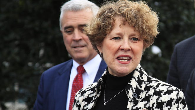 FILE - In this Jan. 15, 2019, file photo, Rep. Susan Brooks, R-Ind., joined by, from back left, Rep. Brad Wenstrup, R-Ohio, speaks to reporters outside the West Wing following a meeting with President Donald Trump about border security at the White House in Washington. (AP Photo/Manuel Balce Ceneta, File)