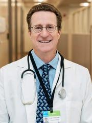 Dr. Douglas Hudson, a physician at the HRHCare Urgent